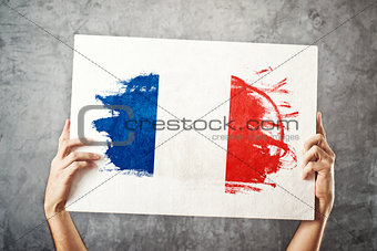 France flag. Man holding banner with French Flag.