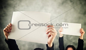 Two women holding blank paper