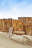 Vintage wooden fence on sandy beach