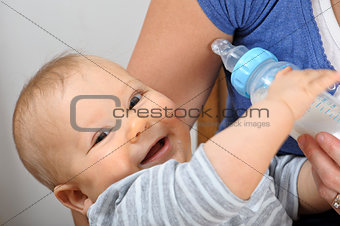 Baby being bottle fed
