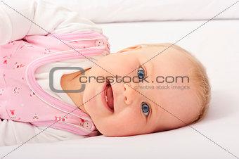 Baby smiling at camera