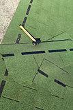 Bitumen roof shingles and hammer