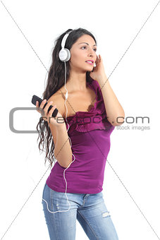 Beautiful woman listening to the music from a smart phone
