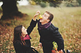 Young sweet couple having date in autumn park.