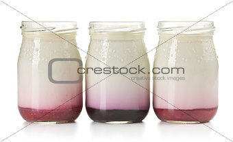 three jars with fruity yogurt