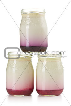three jars with fruity yogurt
