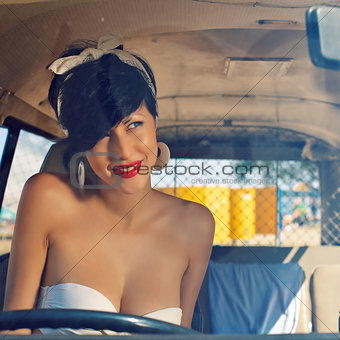 a beautiful retro-looking girl with blue eyes and red lips throu