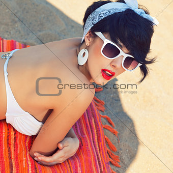 a beautiful young girl in retro look with red lips in a white sw