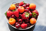Assorted colorful fresh summer berries and fruits