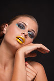 woman with extreme colorfull make up in blue and yellow