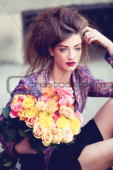 attractive young woman with pink roses