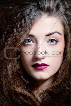 beautiful brunette woman with blue eyes