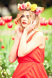 beautiful woman portrait outdoor with colorful flowers