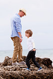 father and son playing outdoor on beach summer vacation