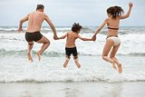 happy family ith two boys having fun in water summer holiday
