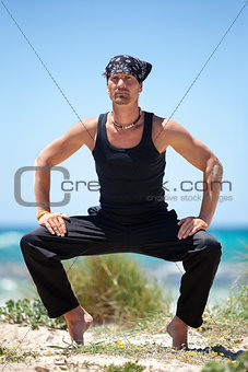 adult healthy man doing pilates yoga exercise