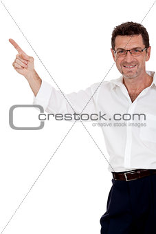 adult attractive smiling man pointing his finger on the copyspace