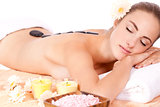 young attractive woman hot stone massage wellness isolated