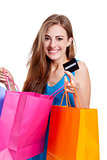 attractive young woman with colorful shopping bags isolated