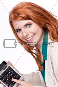 attractive smiling redhead business woman with calculator isolated