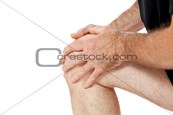 adult attractive man in sportswear knee pain injury ache isolated