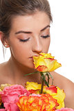 attractive young smiling woman with flowers roses isolated