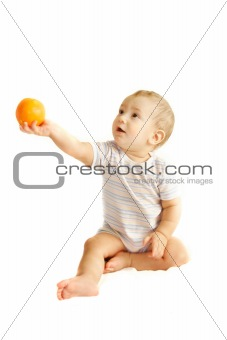 baby boy giving an orange over white