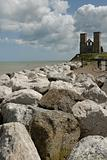 View along the sea defences towards Reculver Abbey.