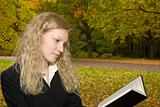 Women reading in the park in Autumn.