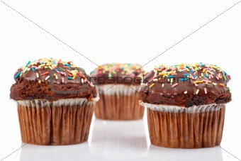 Three muffins with chocolate
