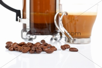 Cup and coffee pot and beans