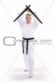 First Degree Black Belt with tonfa.