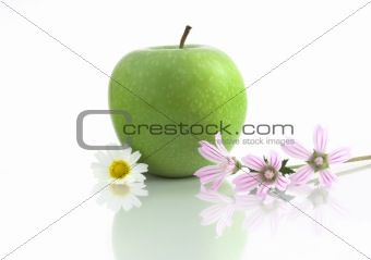 Grenn Apple with flowers and reflection