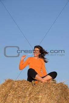 Beautiful woman seated in a field