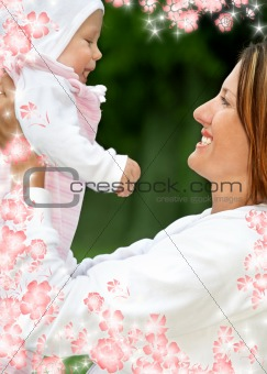 happy mother with baby and flowers