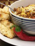 Chili with biscuits and a pepper