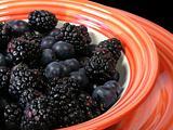 mixed berries in orange bowl