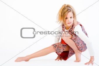 Blond child stretching her leg
