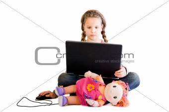 Blond child with doll and notebook