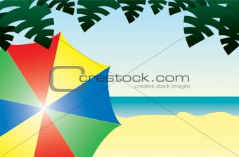 A Beach Scene with a Colorful Umbrella