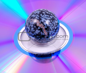 Painted ball on a rainbow surface
