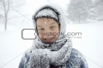 Boy with snow on his eyelashes.