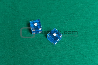 Blue Casino Dice with Snake Eyes showing.