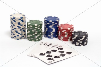 A royal straight flush hand with colored poker chips.