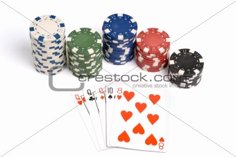 Three of a kind poker hand with colored poker chips.