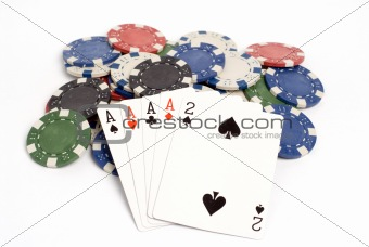 A four of a kind hand with colored poker chips.