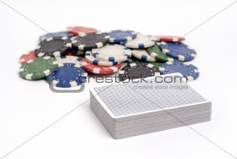 Deck of cards with colored poker chips.