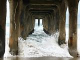 Wave crashing under Pier