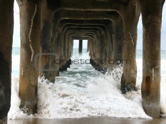 Wave crashing under Pier