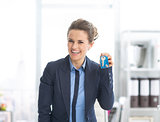 Happy business woman showing keys
